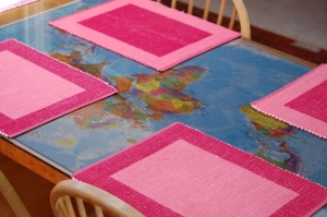 kitchen table with a world map under a sheet of glass