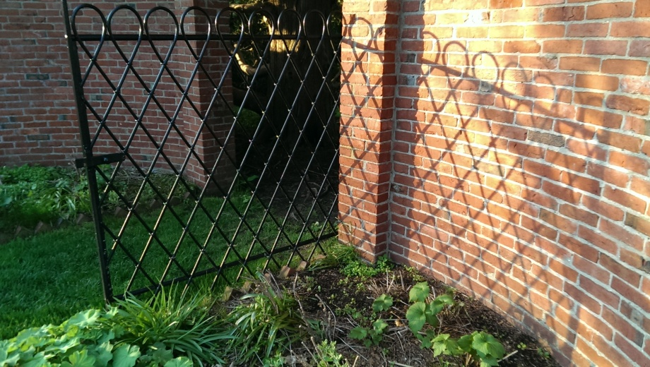 wrought iron gate and its shadow at Stevens Coolidge Place