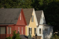 three colorful house gables