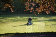man mowing large lawn
