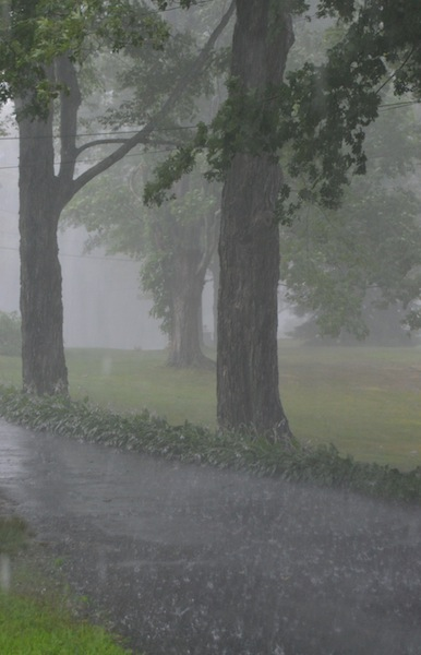 Rain splashing on the driveway