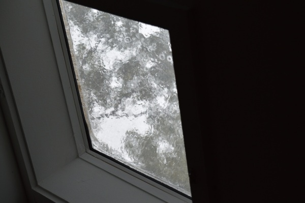 rain splattering on the skylight